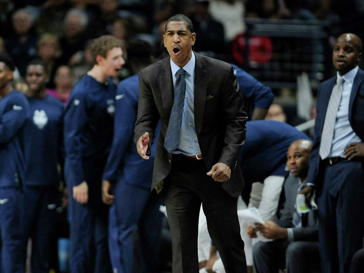 Connecticut head coach Kevin Ollie reacts in the second half of an NCAA college basketball game against Northeastern, Monday, Nov. 14, 2016, in Storrs, Conn.