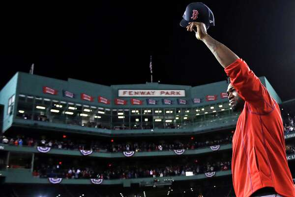 Boston Red Sox's David Ortiz waves from the mound at Fenway Park after Game 3 of baseball's American League Division Series against the Cleveland Indians, Monday, Oct. 10, 2016, in Boston. The Indians swept the Red Sox out of the postseason and sent Ortiz into retirement with a 4-3 victory that completed a three-game American League Division Series sweep.