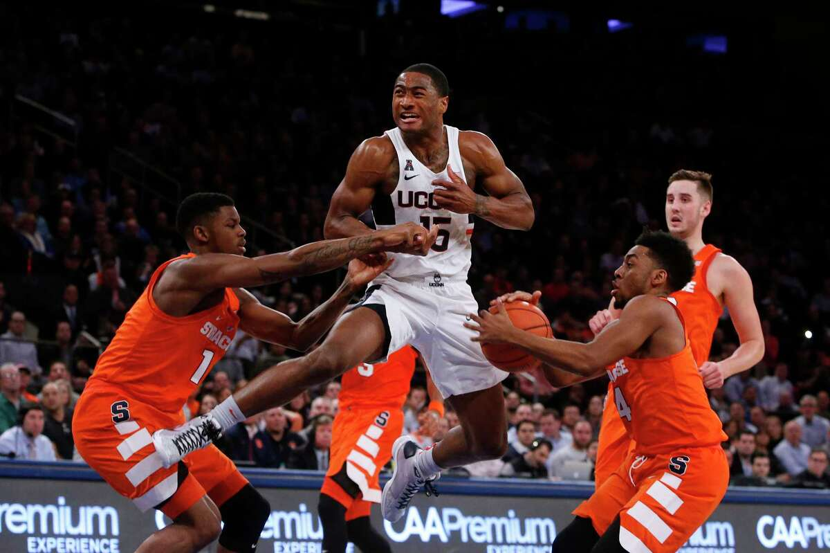 Connecticut's Rodney Purvis (15) has the ball stolen by Syracuse's John Gillon (4) as Syracuse's Franklin Howard (1) defends during the first half of an NCAA college basketball game Monday, Dec. 5, 2016, in New York.