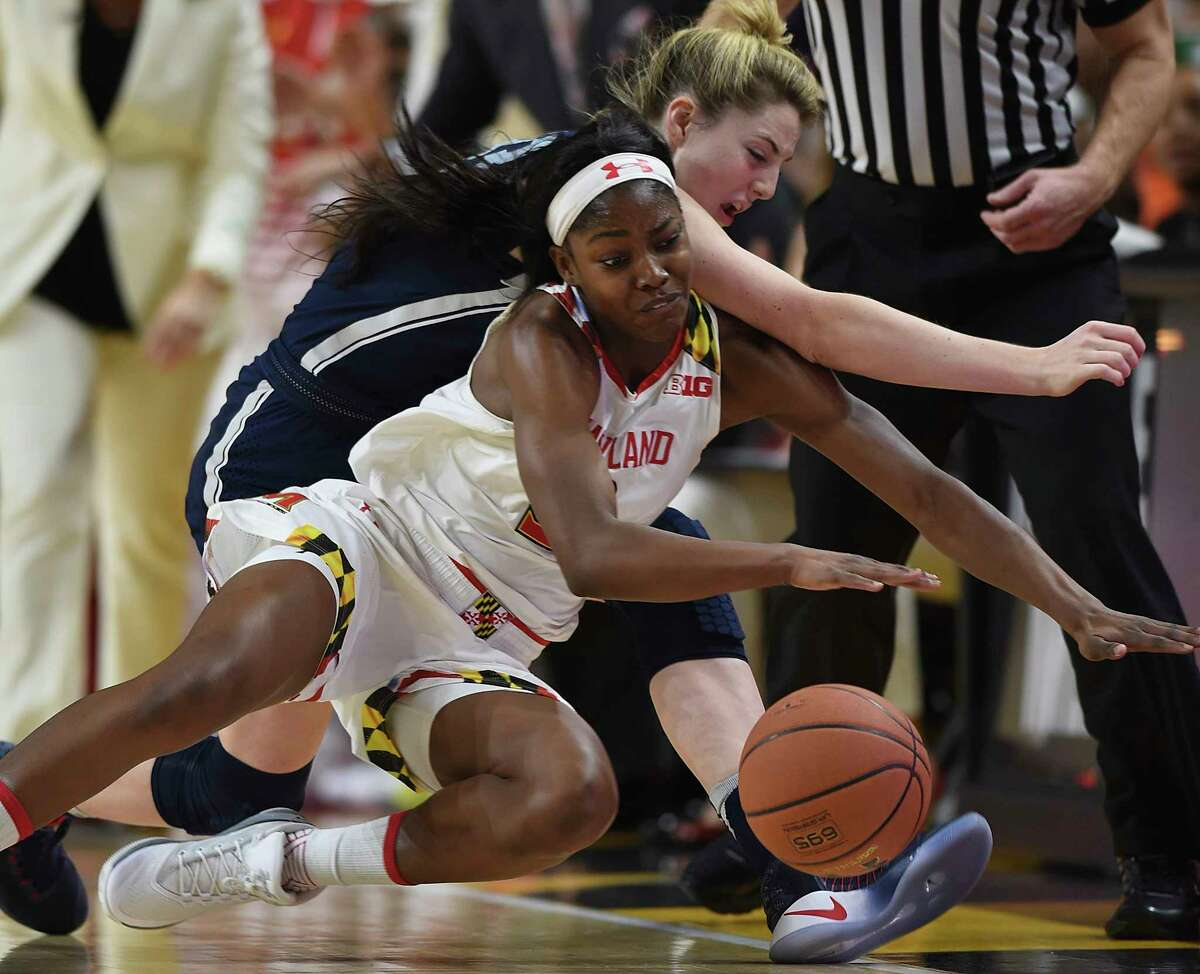 Maryland's Kaila Charles, left and Connecticut's Katie Lou Samuelson chase thee ball during the first half of an NCAA college basketball game, Thursday, Dec. 29, 2016, in College Park, Md.