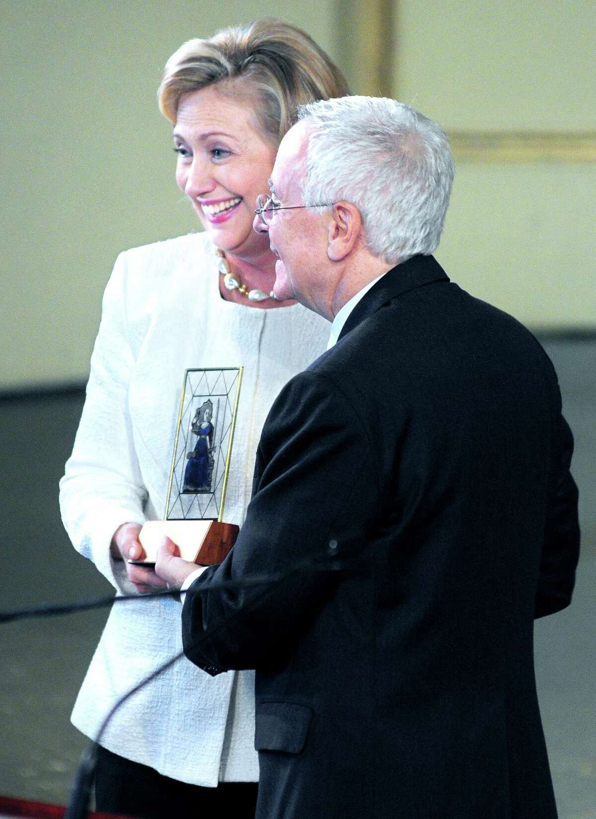 (Arnold Gold ?' New Haven Register) Hillary Clinton receives the Yale Law School Award of Merit from Yale Law School Dean Robert Post during her 40th Yale Law School reunion in New Haven on 10/5/2013.