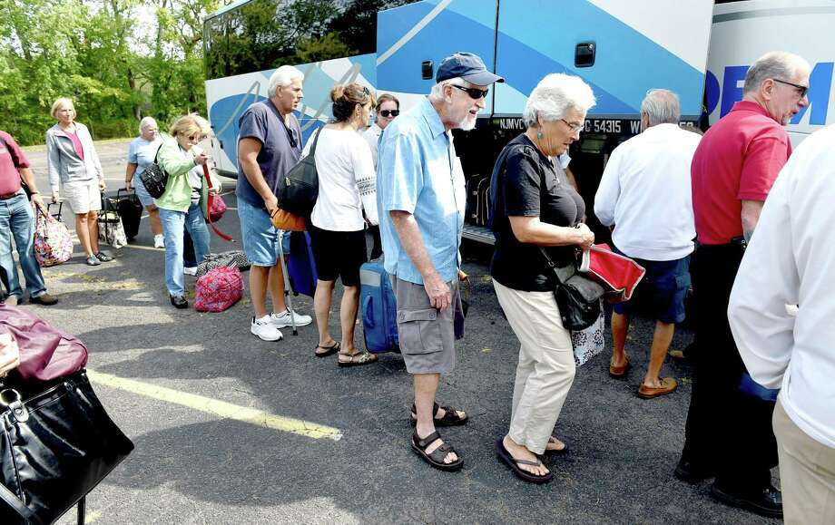 People board a bus in the parking lot of Our Lady of Pompeii Church in East Haven for a trip to Philadelphia and the World Meeting of Families on 9/25/2015.  Photo by Arnold Gold/New Haven Register   agold@newhavenregister.com