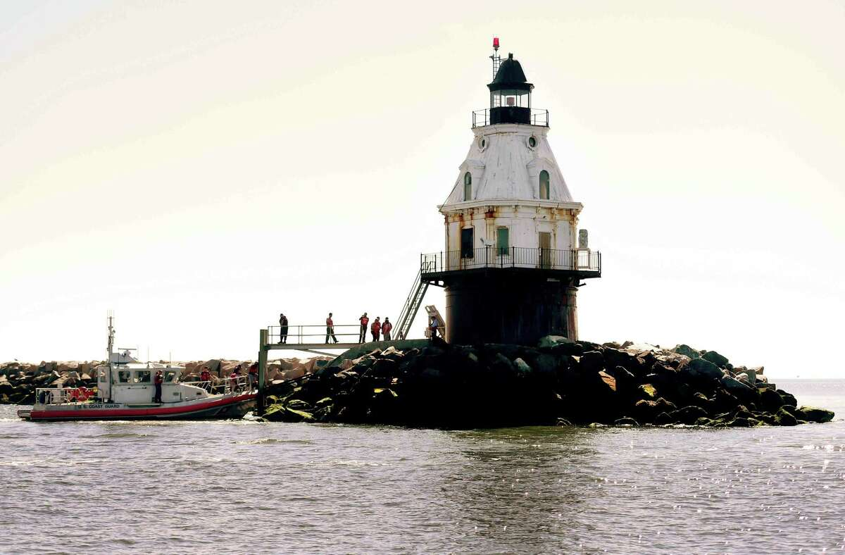 (Peter Hvizdak - New Haven Register) Prospective bidders are brought to the Southwest Ledge Lighthouse in New Haven Harbor for visit Tuesday, August 9, 2016 by the General Services Administration on Coast Guard boat before potential buyers place their bids to the GSA.