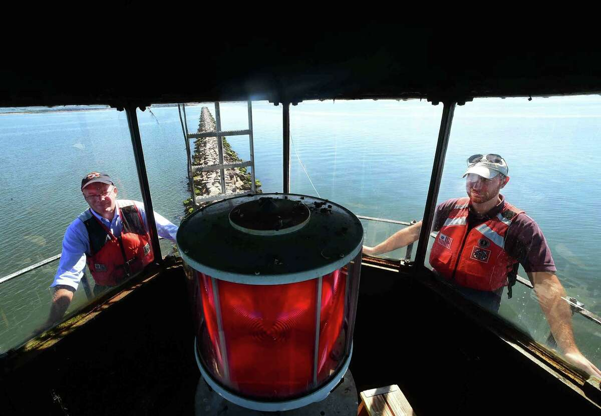 (Peter Hvizdak - New Haven Register) Bob Zarnetski, General Services Administration Regional Administrator left, and Eric Giusti, GSA Real Estate Specialist and Southwest Ledge Lighthouse Project Manager, right, during a visit by prospective bidders brought to the Southwest Ledge Lighthouse in New Haven Harbor that has been put up for sale by the General Services Administration.