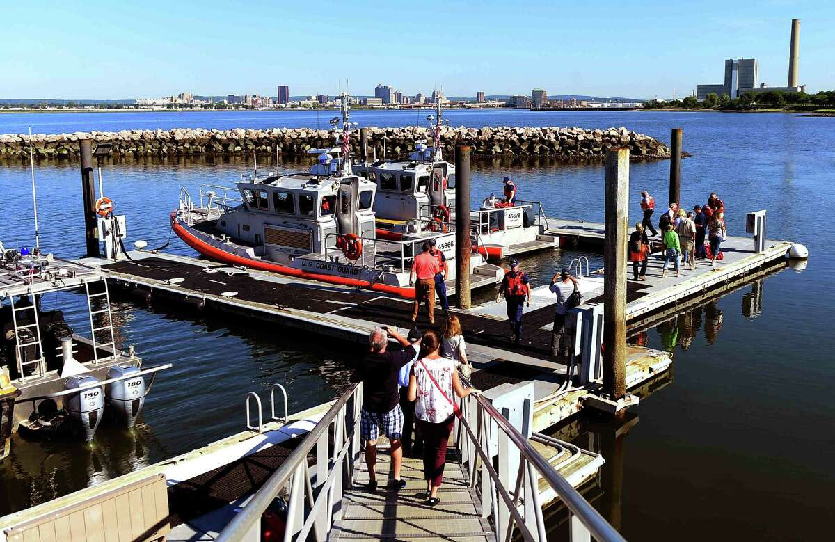 (Peter Hvizdak - New Haven Register) Prospective bidders are brought by Coast Guard boats Tuesday, August 9, 2016 to the Southwest Ledge Lighthouse in New Haven Harbor in New Haven Connecticut which is for sale by the General Services Administration.