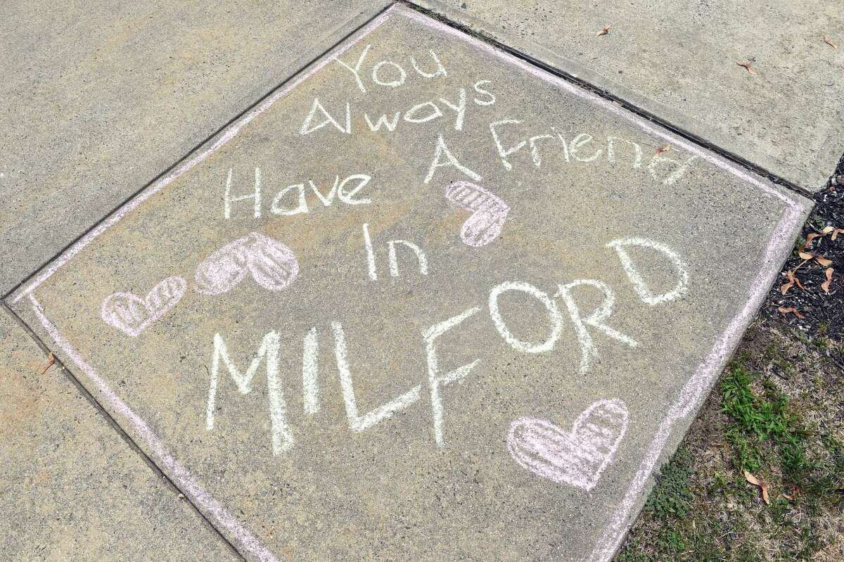 Children draw on the sidewalk in front of City Hall in Milford for Chalk the Walks 2016 on 8/17/2016. Chalk the Walks 2016 is a collaboration between the Milford Prevention Council and the City of Milford and is one of the River Street Wednesday activities. Photo by Arnold Gold/New Haven Register agold@newhavenregister.com