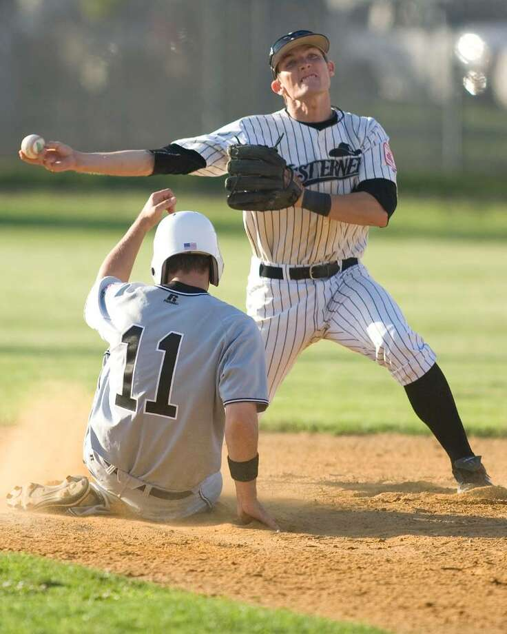 Westerners second baseman Tucker Nathans gets the force on a sliding Joseph Martin of the Bristol Collegiate, but fires to first too late to complete the double play Tuesday night at Rogers Park. Photo: Barry Horn / The News-Times Freelance