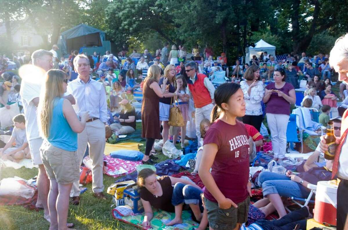 People gather on the lawn for the opening night of Shakespeare on the Sound's presentation of Othello at Pinkney Park in Rowayton Tuesday June 15, 2010. Shows start at 730pm and continue through June 26 with no Monday performances.