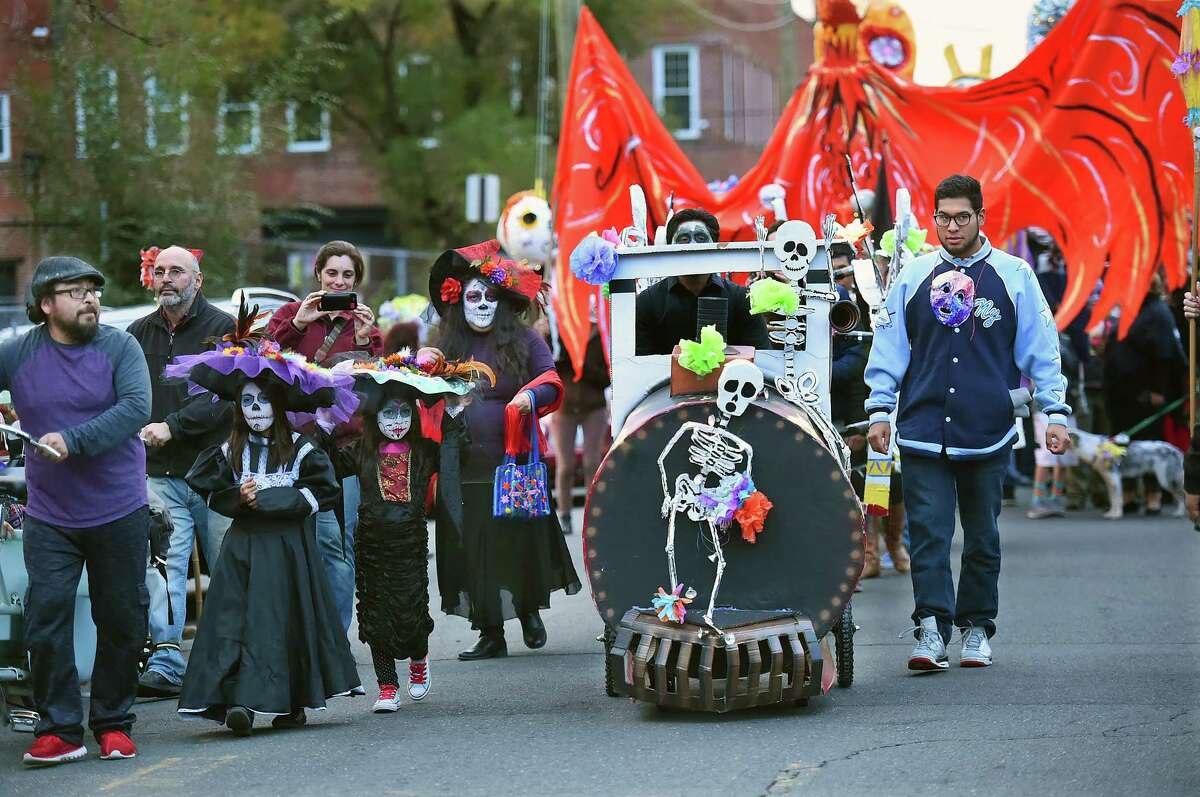 The Carnaval del Dia de los Muertos - Day of the Dead parade sponsored by Unidad Latina en Accion and Esperanza Center for Law and Advocacy makes its way down Saltonstall Avenue in New Haven, Saturday, November 5, 2016. (Catherine Avalone/New Haven Register)
