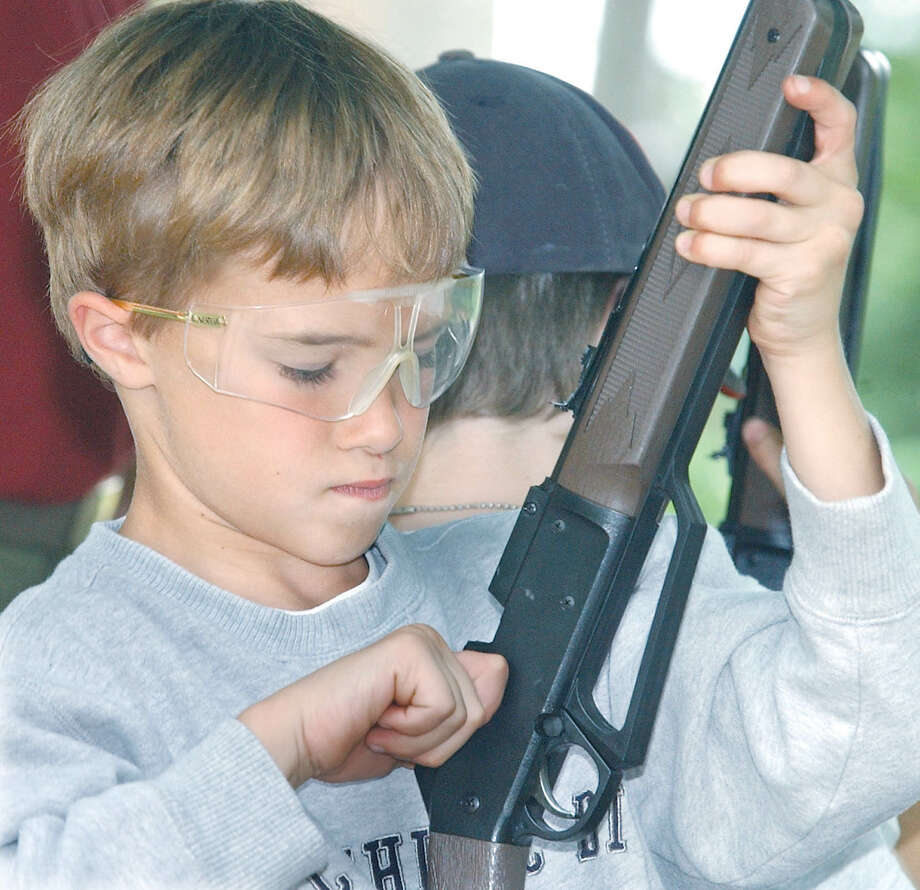 In this file photo, a boy is shown loading a BB gun. Webb County Sheriff Martin Cuellar is warning the community on the use of BB guns and pellet guns, which can be mistaken for assault-type weapons.