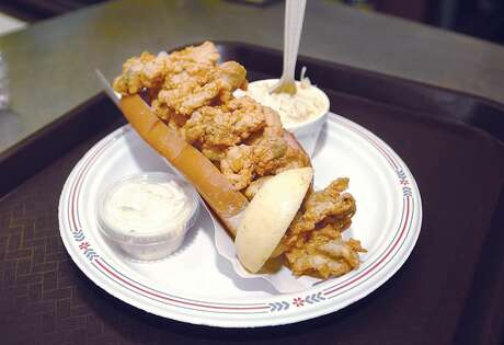 The clam roll sandwich is one of the more popular lunches served at Johnny Ad's Seafood Restaurant in Old Saybrook.