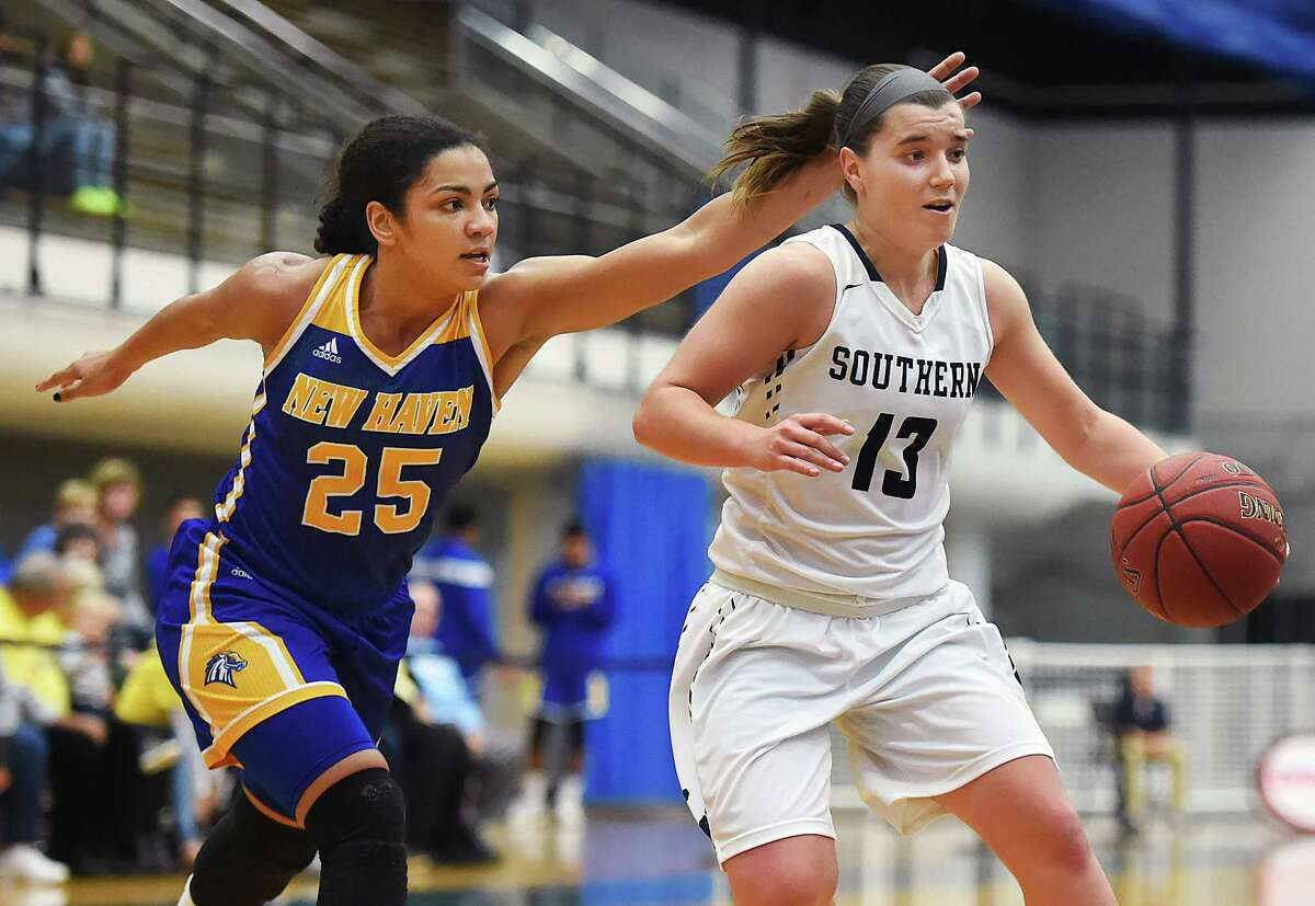 SCSU senior guard Maria Weselyj drives to the hoop for two as UNH sophomore guard Alexandria Kerr defends, Wednesday, November 30, 2016, at the Moore Field House at Southern Connecticut State University. The Owls won, 79-54. (Catherine Avalone/New Haven Register)