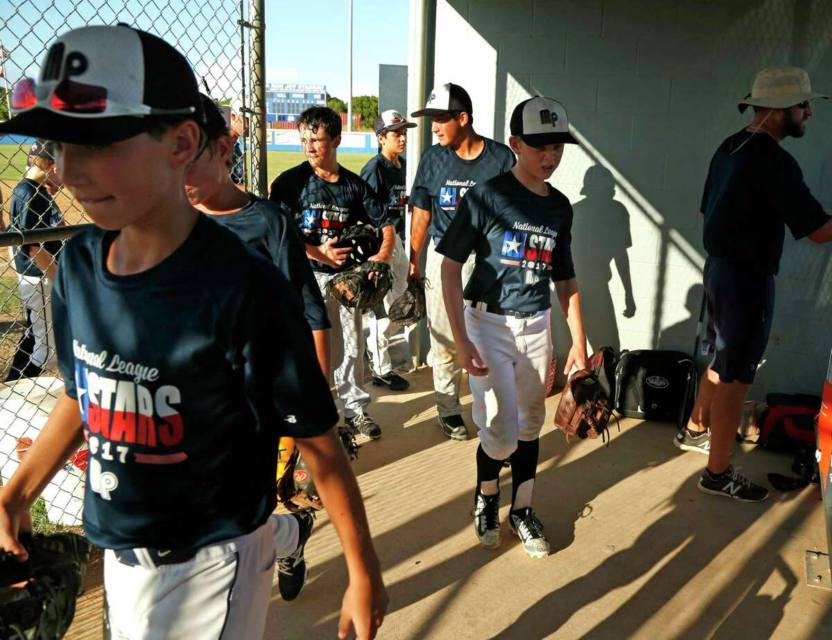 McAllister Park Little League team comes in for a break on July 26, 2017, during preparation for the Southwestern Regional tournament.