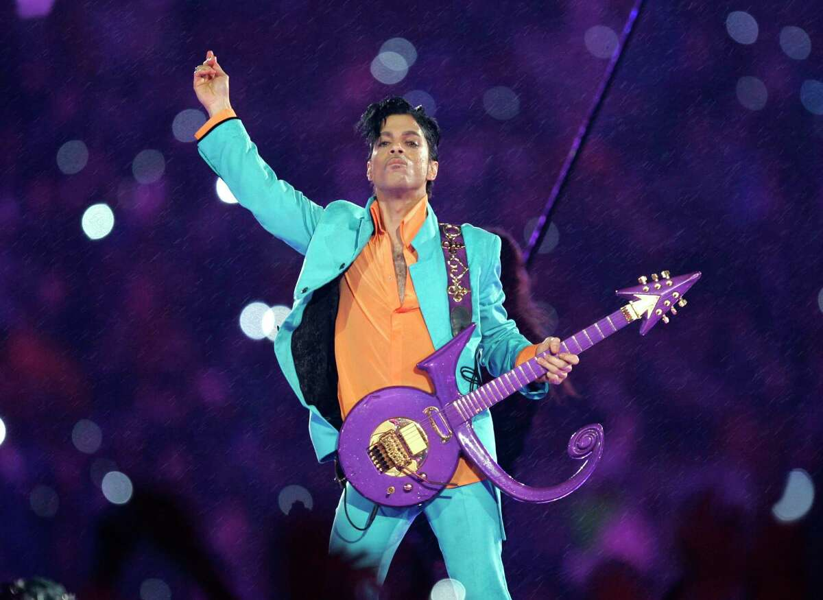 FILE - In this Feb. 4, 2007 file photo, Prince performs during the halftime show at the Super Bowl XLI football game at Dolphin Stadium in Miami. Widely acclaimed as one of the most inventive and influential musicians of his era with hits including