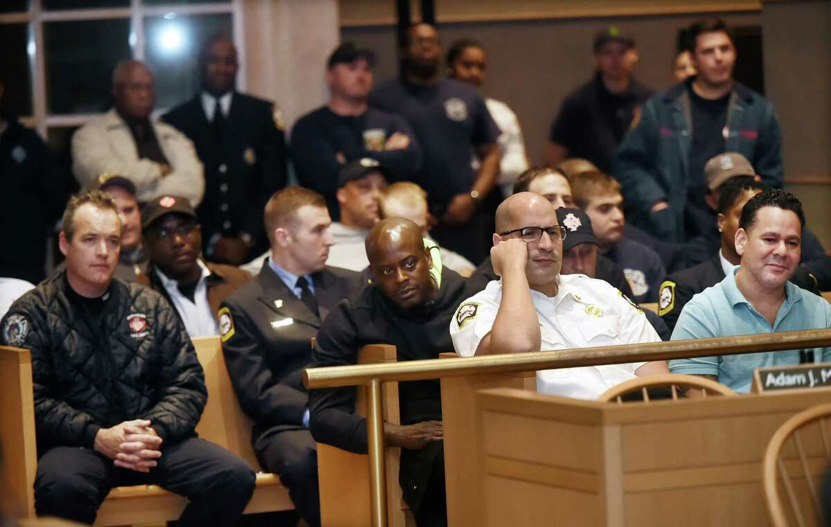Members of the New Haven Fire Department attend the Board of Alders aldermanic affairs committee where Fire Chief John A. Alston, the sole finalist vying for the position of fire chief at the New Haven Fire Department speaks, Thursday, September 29, 2016, introducing himself and his management style. (Catherine Avalone/New Haven Register)