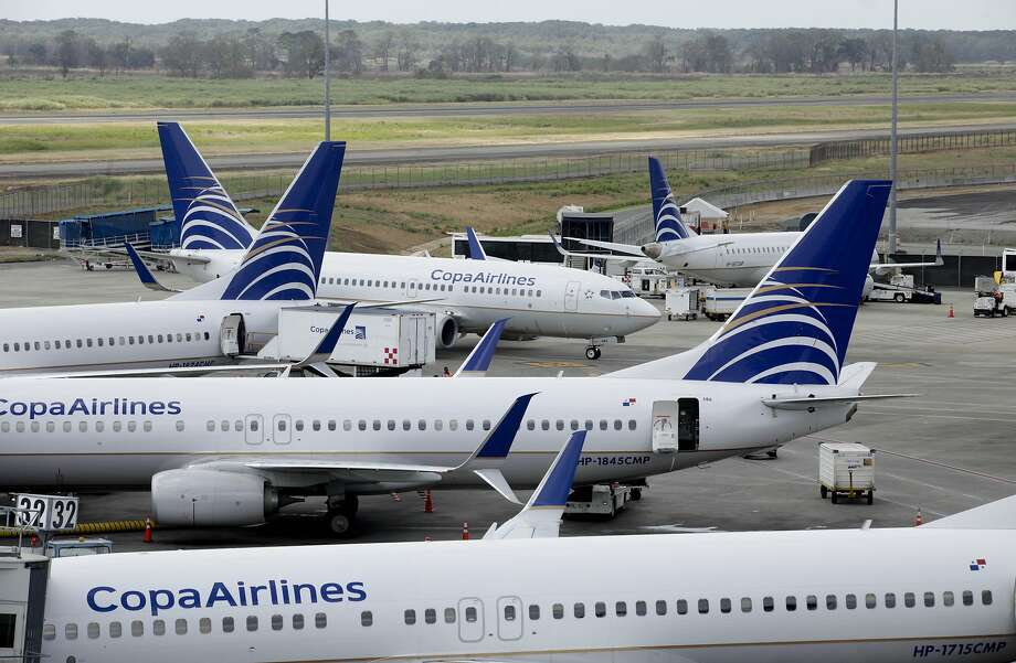 Copa Airlines jetliners sit on the tarmac of Tocumen International Airport in Panama City, Tuesday, March 8, 2016. On Tuesday, a 17-year-old passenger on a Boeing 737 Copa flight from Panama City was detained after he opened an exit door as the plane landed at San Francisco International Airport, stepped onto the wing and jumped to the runway. Photo: Arnulfo Franco, AP
