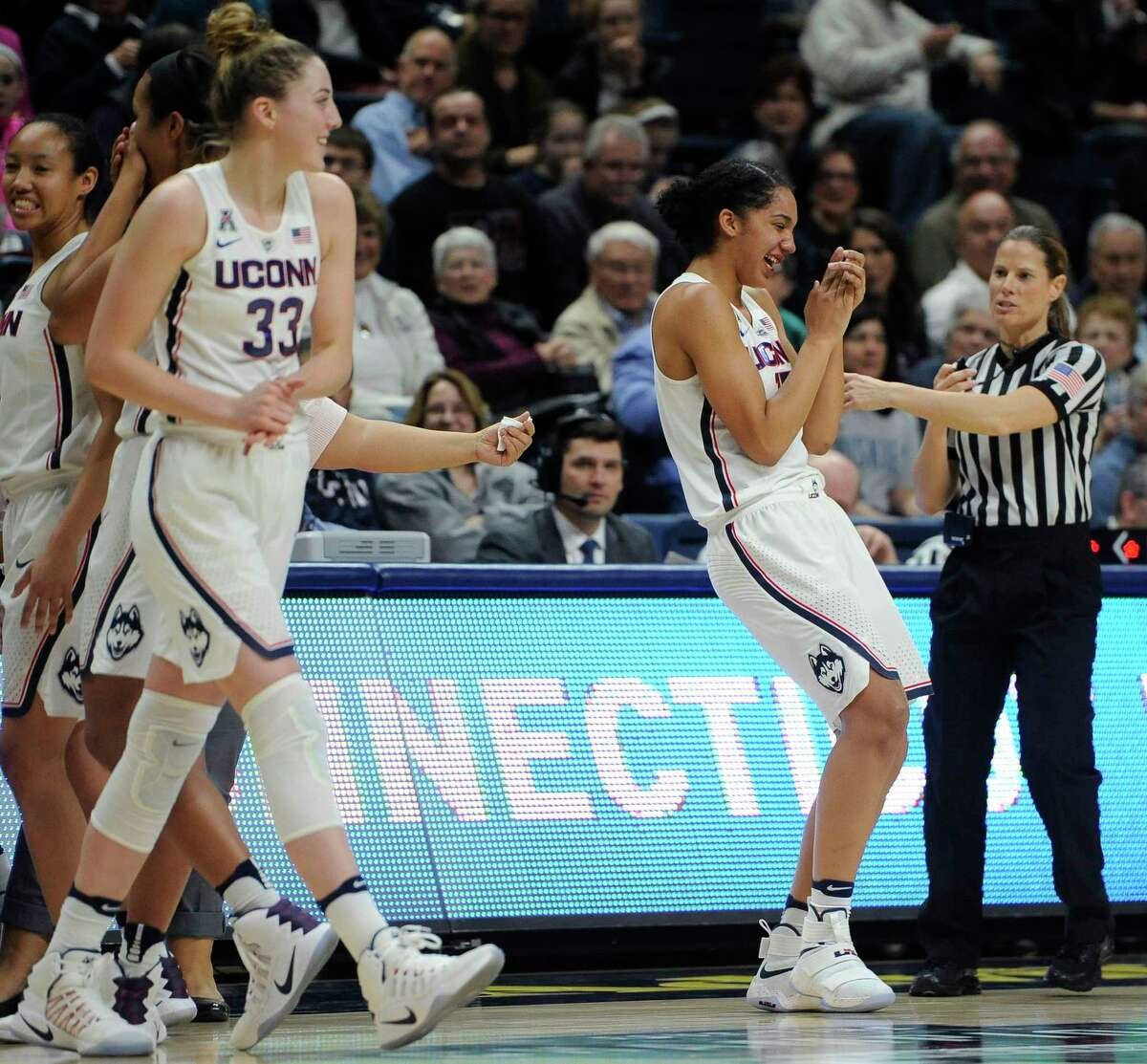 Connecticut's Gabby Williams, front right, reacts after taking an elbow to her tooth in the second half of an NCAA college basketball game against Tulane, Sunday, Jan. 22, 2017, in Storrs, Conn.