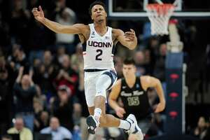 Connecticut's Jalen Adams leaps in the air to celebrate UConn taking the lead in the second half of an NCAA college basketball game against Tulane, Saturday, Jan. 28, 2017, in Storrs, Conn.