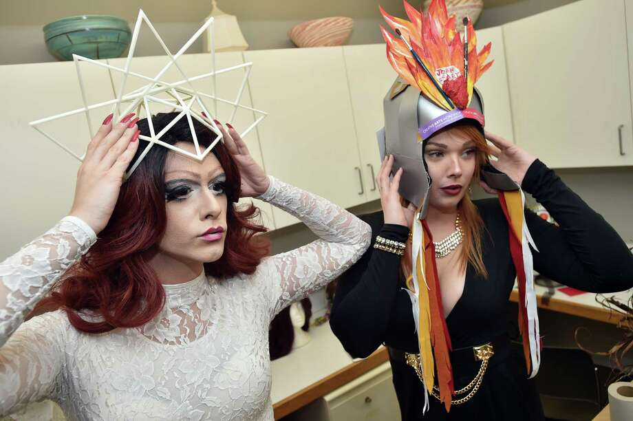 Drag queens Kiki Lucia and Casey Fitzpatrick try on hats they will be modeling at Hats Off!, a fashion show of whimsical headwear modeled by sponsored by Fashionista Vintage and 116 Crown Friday, March 3, 2017, at the Creative Arts Workshop at 80 Audubon St. in New Haven. The fundraiser will benefit CAW, a non-profit community art center focusing on the visual arts since 1961. (Catherine Avalone/New Haven Register) Photo: Catherine Avalone / New Haven RegisterThe Middletown Press
