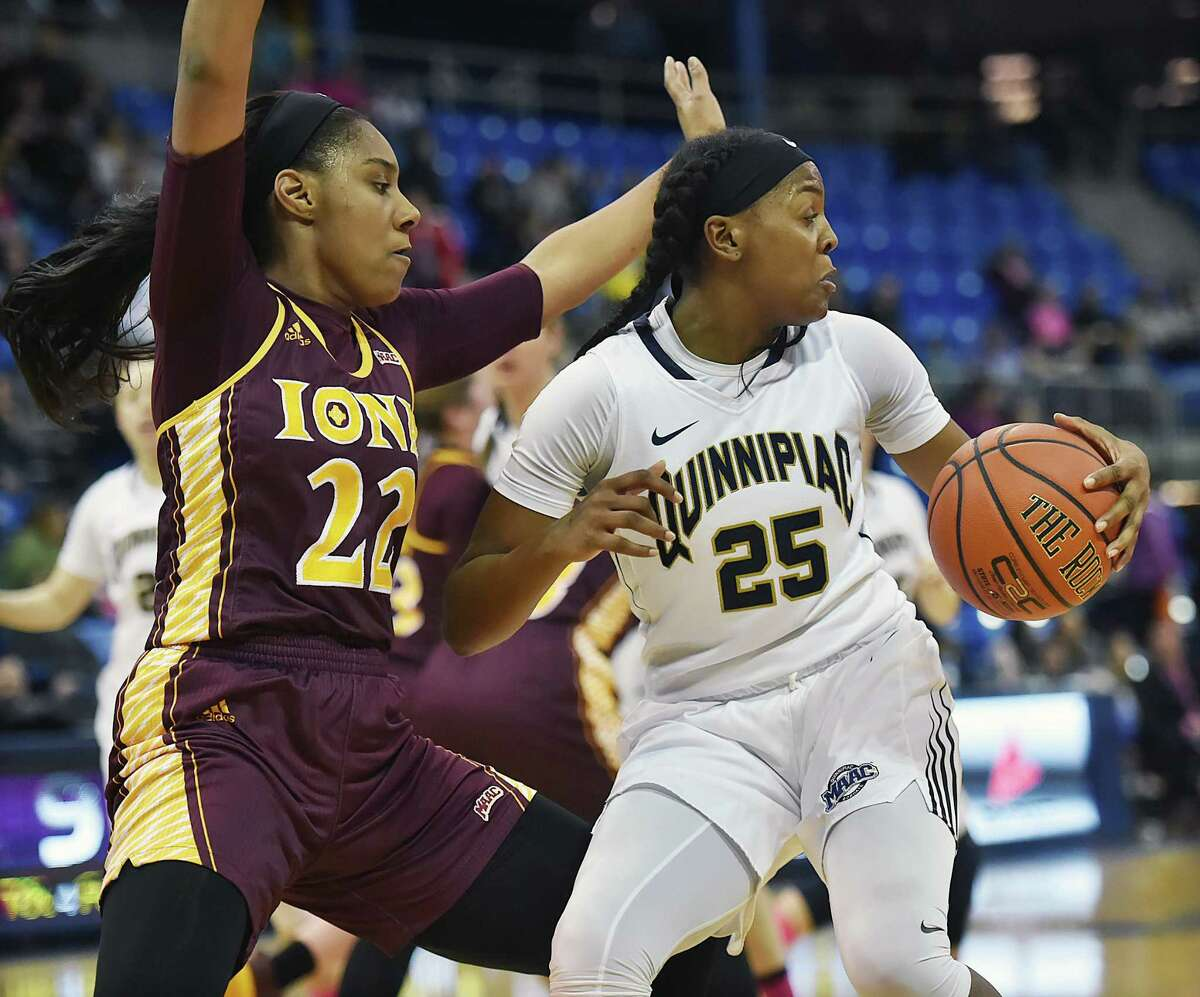 Quinnipiac guard/forward Aryn McClure looks to make a move on Iona forward Treyanna Clay as the Bobcats defeat the Gaels, 53-45, Friday, Feb. 17, 2017, at the TD Bank Sports Center at Quinnipiac University in Hamden.