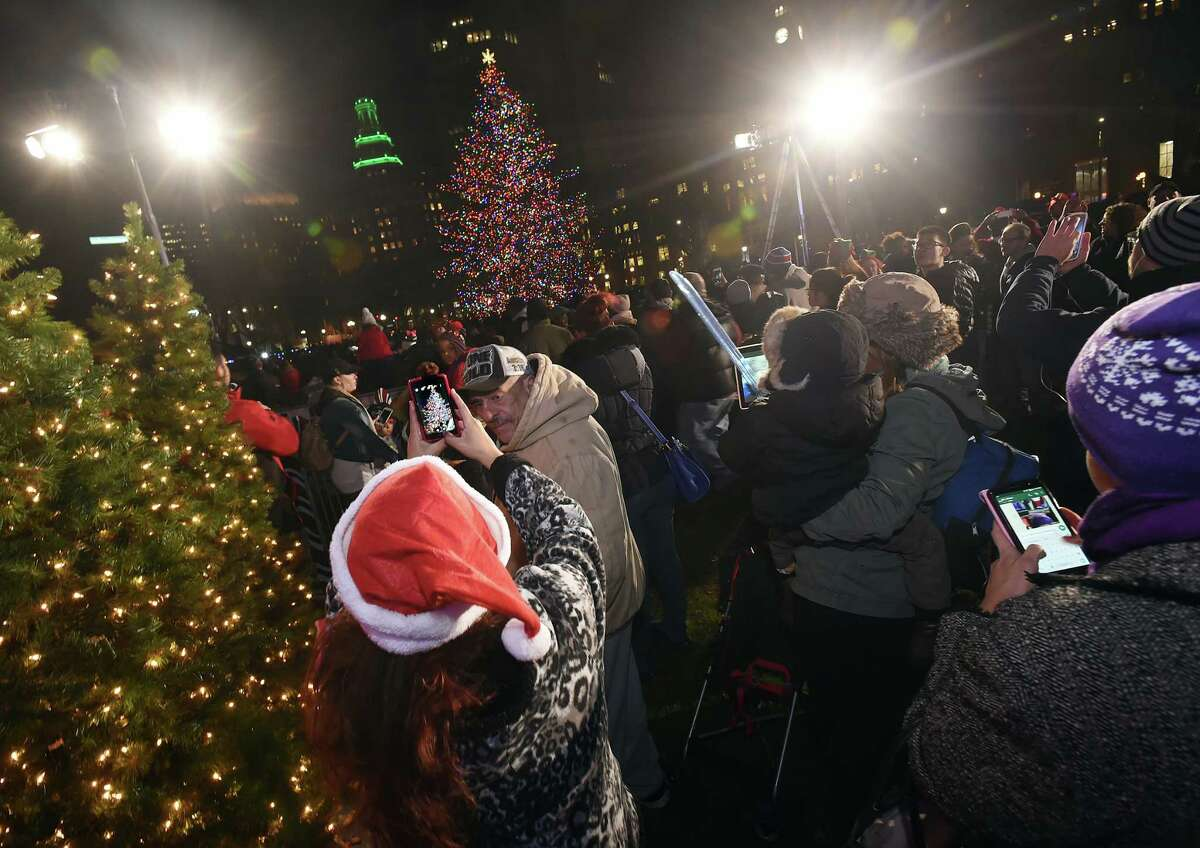Scenes from the city's annual lighting of the Christmas Tree, Thursday, December 1, 2016, on the historic New Haven Green. (Catherine Avalone/New Haven Register)
