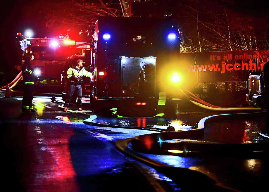 (Peter Hvizdak - New Haven Register) Emergency personnel on the drive leading to the entrance of the Jewish Community Center where there was a fire Monday evening, December 5, 2016. Photo: Peter Hvizdak, ©2016 Peter Hvizdak / ©2016 Peter Hvizdak