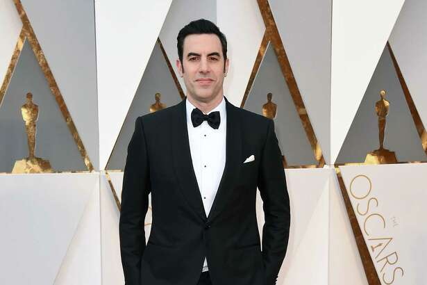 Sacha Baron Cohen arrives at the Oscars on Sunday, Feb. 28, 2016, at the Dolby Theatre in Los Angeles.