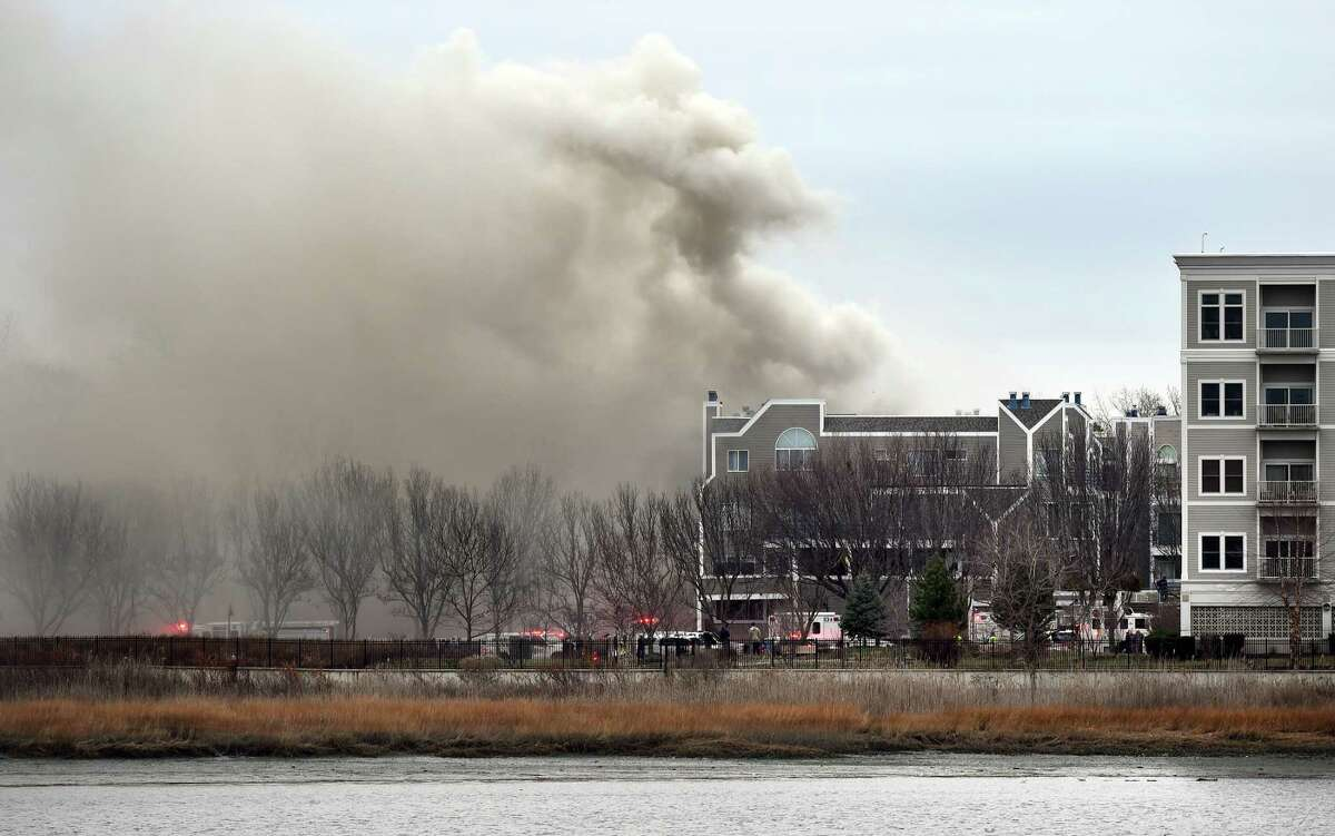 The New Haven Fire Department battles a blaze at Harbour Landing in New Haven on 12/26/2016. Photo by Arnold Gold/New Haven Register agold@newhavenregister.com