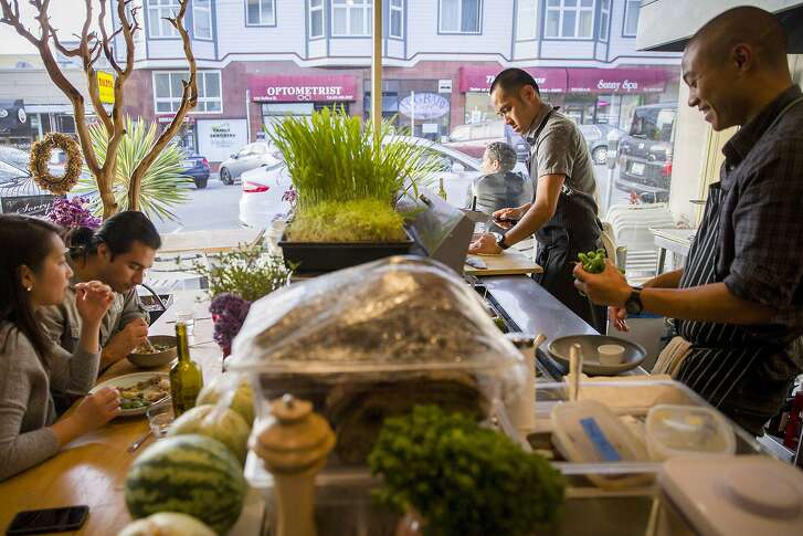 Kris Toliao, second from right, prepares a meal on Friday, July 28, 2017, in San Francisco, Calif. The restaurant is located at 3519 Balboa St. Toliao is the co-owner.