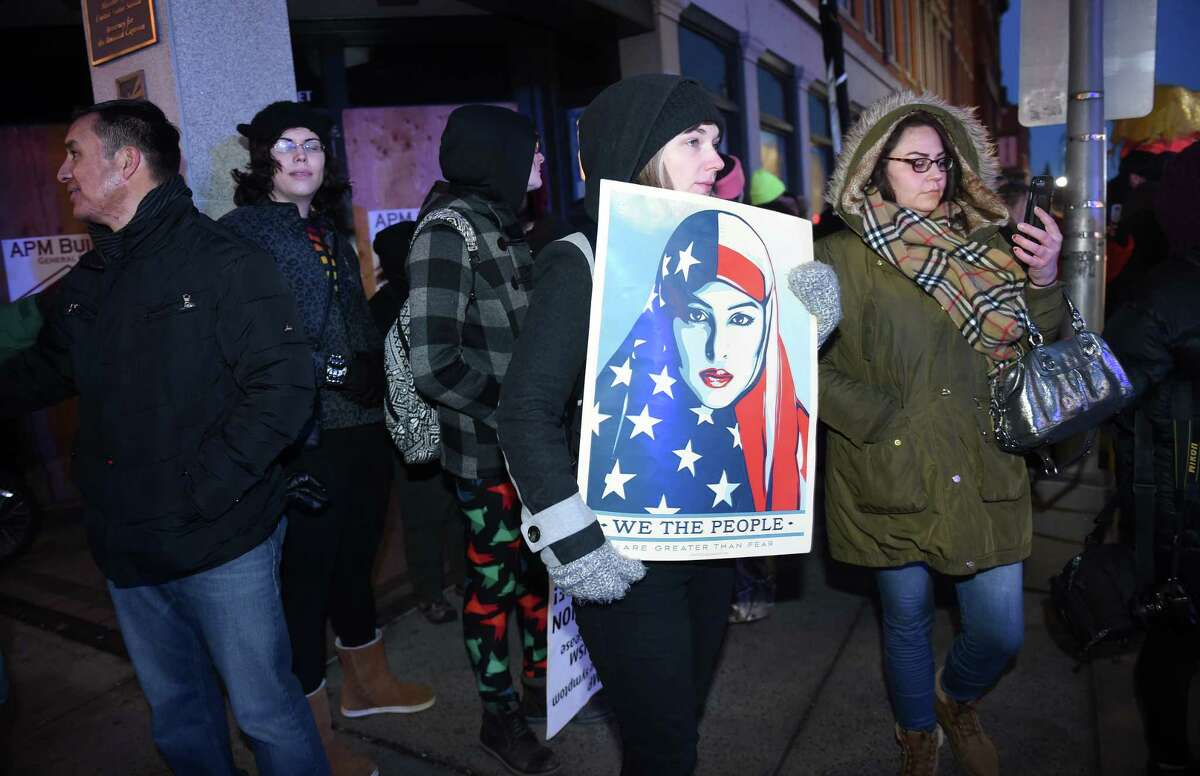 Shannon Kiley (center) of New Haven participates in a protest against federal immigration policy at the corner of Church St. and Chapel St. in New Haven on 2/4/2017. The protest temporarily closed Rt. 34 earlier. Photo by Arnold Gold/New Haven Register agold@newhavenregister.com