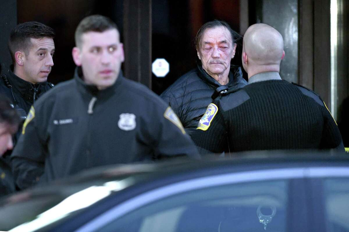 Norm Clements (second from right) is detained by New Haven and Connecticut State Police on Chapel St. following a protest against federal immigration policy that temporarily closed Rt. 34 northbound in New Haven on 2/4/2017. Photo by Arnold Gold/New Haven Register agold@newhavenregister.com
