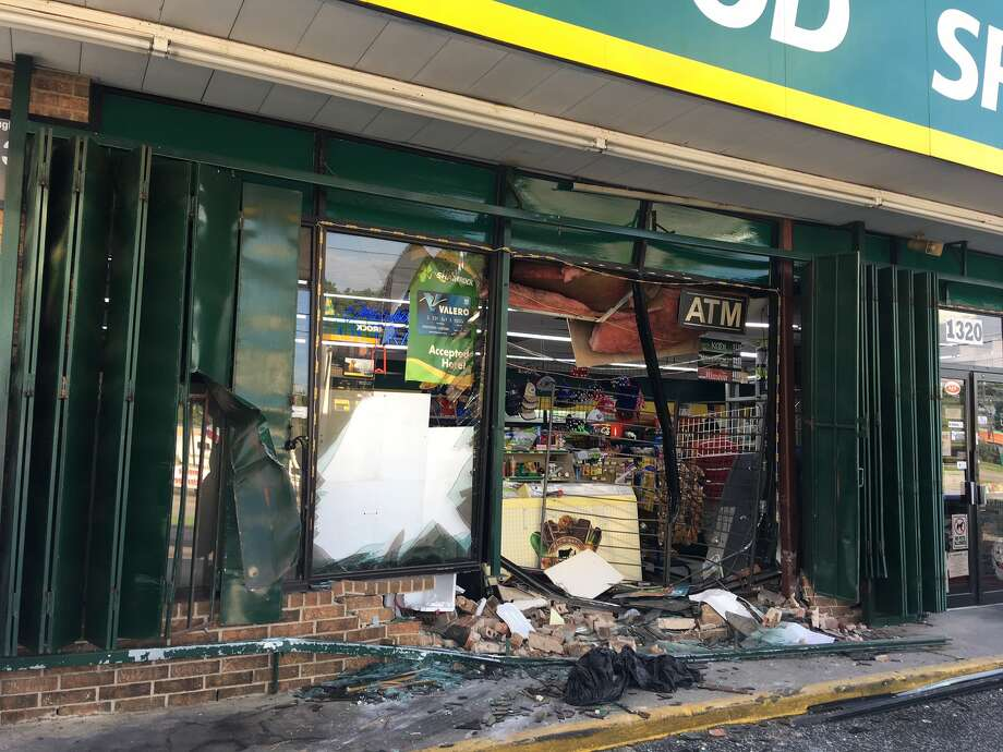 An 11th Street convenience store was one of two businesses damaged by stolen trucks early Wednesday, August 2, 2017. Photo: Tim Collins/The Enterprise