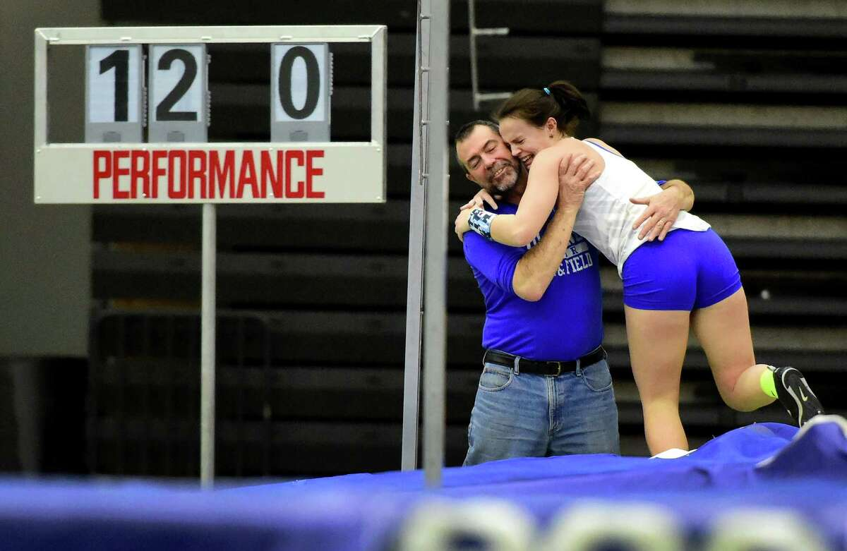 (Peter Hvizdak - New Haven Register) Amyerin Zadroga of Tolland H.S. hugs her coach and father Rich Zadrosa after she set a new girls poll vault record of 12-feet during 2017 CIAC Class M Indoor Track Championships at the Floyd Little Athletic Center in New Haven Monday, February 13, 2017.