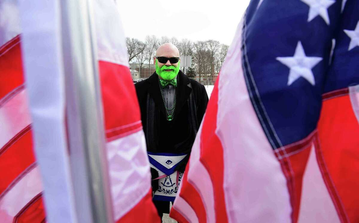 (Peter Hvizdak - New Haven Register) John Hanson of Milford waits to march in the Milford St. Patrick's Day Parade with the Masonic Ansantawae Lodge 89 of MIlford Saturday afternoon March 18, 2017. See Photo Gallery of the St. Patrick's Day at photos.newhavenregister.com