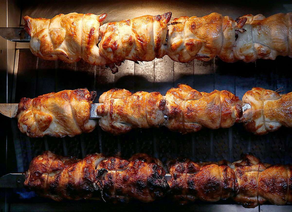 FILE-- Chicken on the rotisserie at RT Rotisserie on Monday, July 31, 2017, in San Francisco.