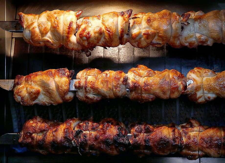 RT Rotisserie: Chicken on the rotisserie. Photo: Liz Hafalia, The Chronicle