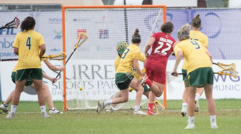 New Canaan graduate Olivia Hompe (22) scores for England in the Bronze Medal game of the Women's Lacrosse World Cup against Australia. Photo: Adam Scott / Contributed Photo
