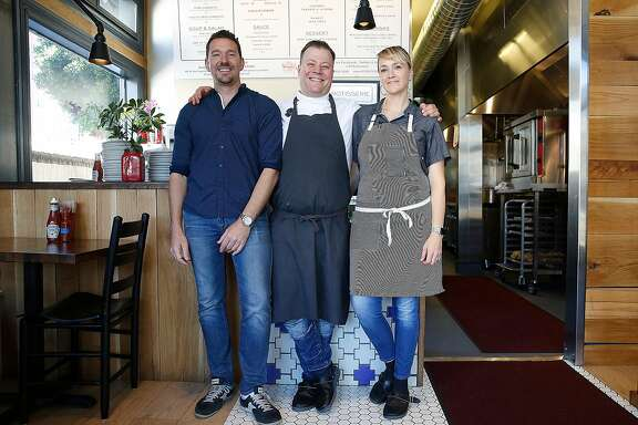 Partner Johnny Gilbert (left), owner and chef Evan Rich, and his wife Sarah Rich at RT Rotisserie on Monday, July 31, 2017, in San Francisco, Calif.