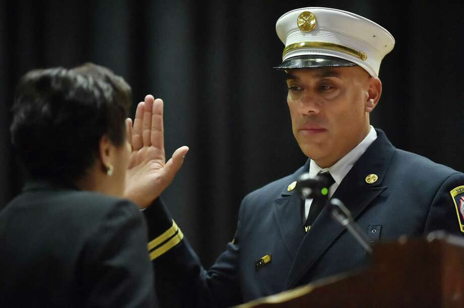 Mayor Toni N. Harp swears in Battalion Chief Mark Vendetto as Assistant Chief of Operations at the City of New Haven Department of Fire Services promotional ceremony, Friday, April 21, 2017, at James Hillhouse High School. (Catherine Avalone-New Haven Register) Photo: Catherine Avalone, Catherine Avalone/New Haven Register / Catherine Avalone/New Haven Register