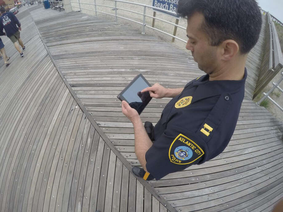An officer in Atlantic City uses a portable tablet on duty. FirstNet, a new broadband network created for police, fire and paramedics will give first responders priority access to cell towers and enable different departments to talk to each other. Photo: FirstNet. / FirstNet