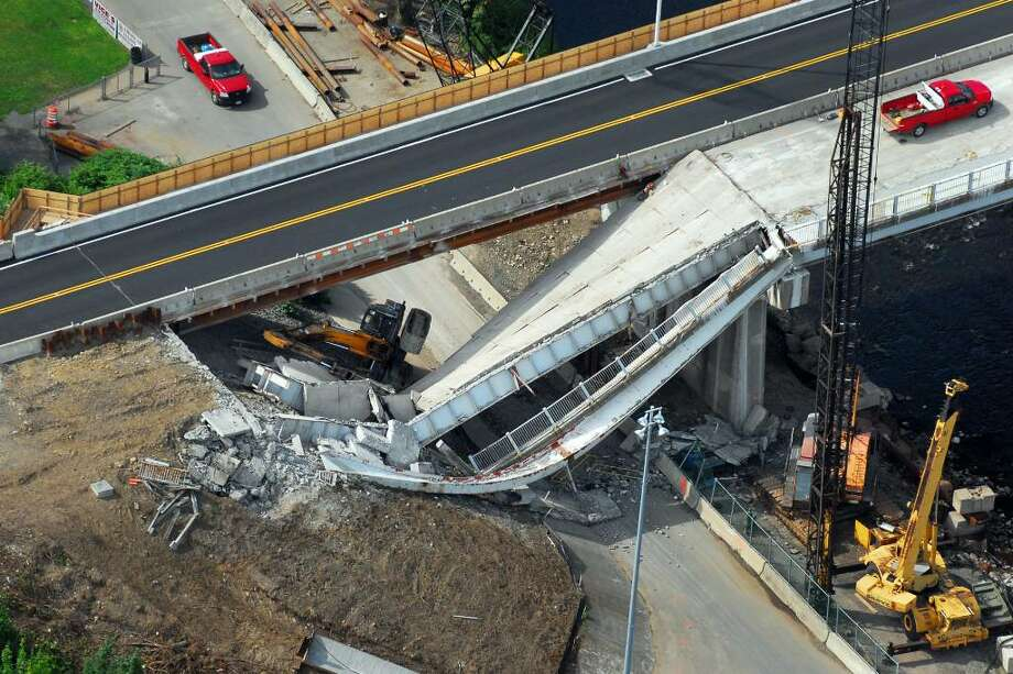 The scene of a bridge that collapsed on Route 63 in Naugatuck, Conn. on Tuesday, June 15, 2010. Morgan Kaolian AEROPIX Photo: Morgan Kaolian AEROPIX / Morgan Kaolian AEROPIX