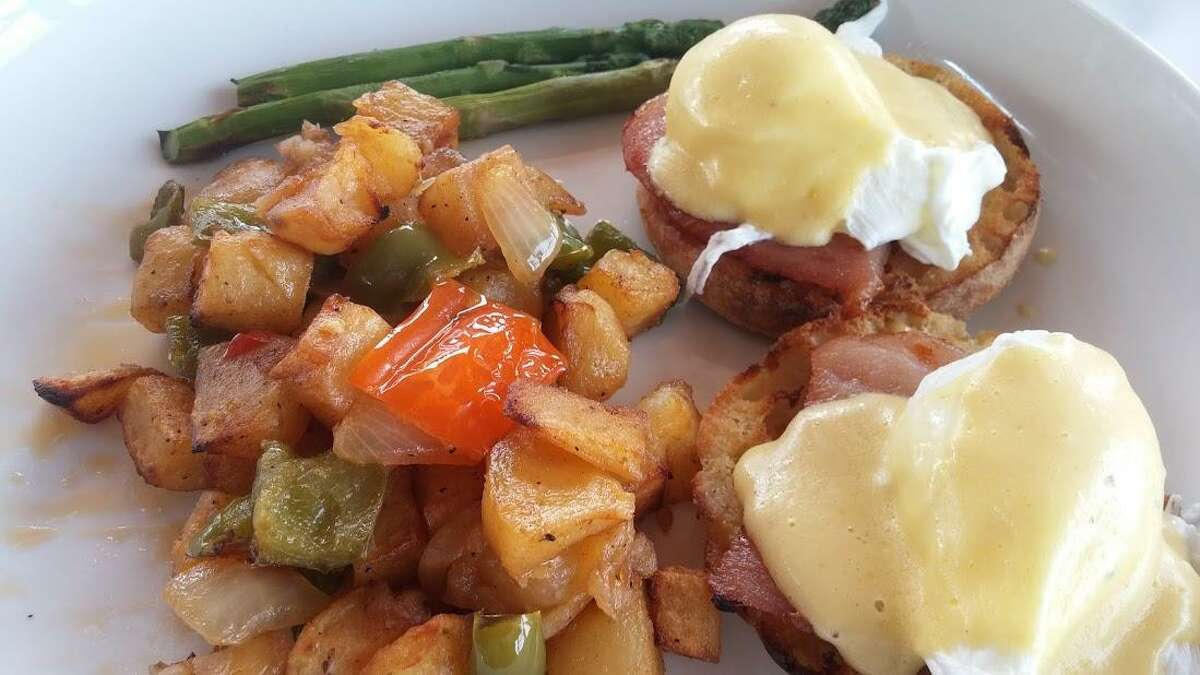 With competition from summer activities and out-of-town travels, demand for brunch is down in July and August. Restaurant managers are happy to confide that this is the best time of year to enjoy their brunch menus. Once the cool weather returns, brunch business picks up. Here, eggs Benedict at Harbor Lights.