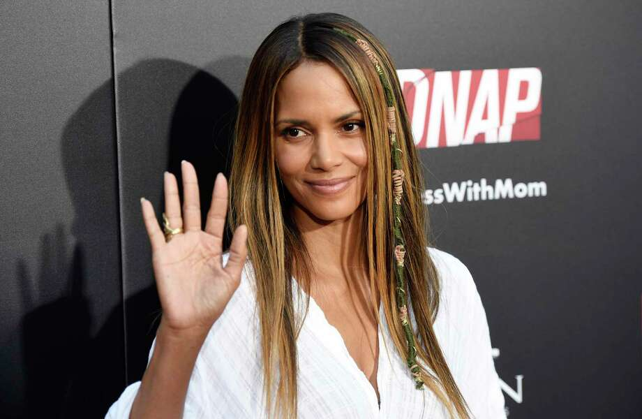 "Halle Berry, a cast member in ""Kidnap,"" waves to photographers at the premiere of the film at the ArcLight Hollywood on Monday, July 31, 2017, in Los Angeles. (Photo by Chris Pizzello/Invision/AP) ORG XMIT: CACP102 Photo: Chris Pizzello / 2017 Invision"