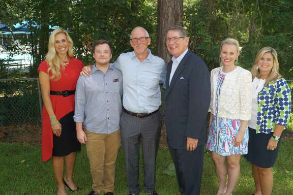 Missy Herndon (left), president and CEO of Interfaith of The Woodlands, congratulates Rob Johnson (center) for being named a 2017 Hometown Hero, pictured with Matt Johnson, (secondfrom left), Dr. Daniel T. Hannon, 2008 Hometown Hero, (thirdfrom right), Meagan Jamaluddin, director of Development, Interfaith of The Woodlands (secondfrom right) and Shannon Mills, director of Communications & Publications, Interfaith of The Woodlands (far right).