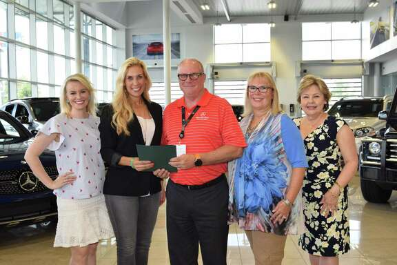 Meagan Jamaluddin, director of Development, Interfaith of The Woodlands (far left), and Missy Herndon, president & CEO, Interfaith of The Woodlands (secondfrom the left), congratulate Bob Milner, 2017 Hometown Hero (thirdfrom left), Teresa Milner (secondfrom right) and Terry Larson (far right).