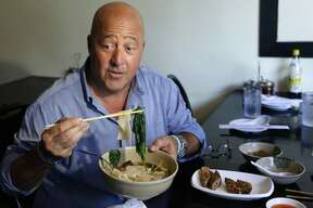 """In this Thursday, July 20, 2017 photo, Travel Channel's """"Bizzare Foods"""" host Andrew Zimmern, a four-time James Beard award-winning chef, samples Taiwanese noodle soup and pork roll at Happy Stony Noodle in Elmhurst, Queens in New York. His new show, """"The Zimmern List,"""" debuts in early 2018 showcasing his personal favorite places to eat when the cameras aren't rolling. (AP Photo/Kathy Willens)"""