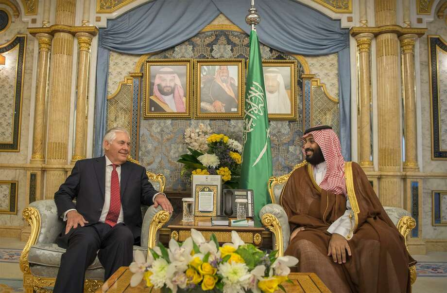 A handout picture provided by the Saudi Royal Palace on July 12, 2017 shows Crown Prince Mohammed bin Salman (R) meeting with US Secretary of State Rex Tillerson in Jeddah. While the government is still aiming for a Saudi Aramco IPO in the second half of next year, that timetable is increasingly tight for what's likely to be the biggest share sale in history. Photo: BANDAR AL-JALOUD /AFP /Getty Images / AFP or licensors
