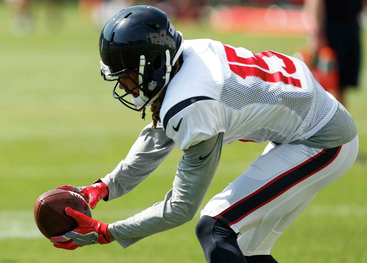 Houston Texans wide receiver Will Fuller (15) reaches down to make a catch during training camp at the Greenbrier on Wednesday, Aug. 2, 2017, in White Sulphur Springs, W.Va.