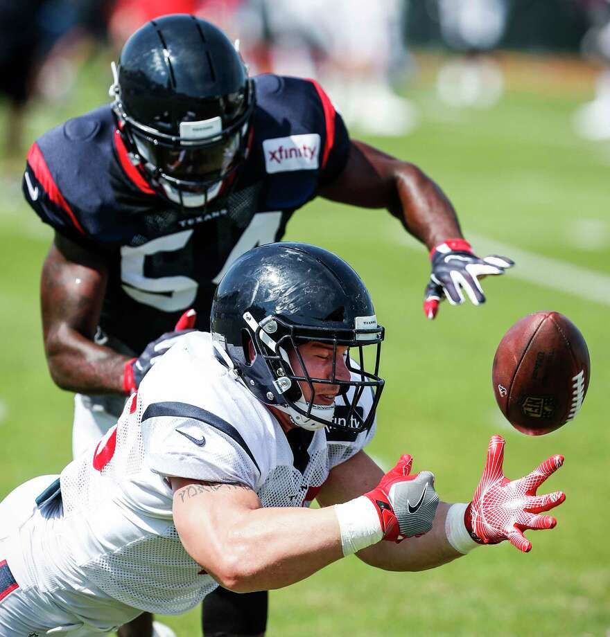 Houston Texans fullback Jay Prosch (45) loses the handle on a pass defended by linebacker Sio Moore (54) during training camp at the Greenbrier on Wednesday, Aug. 2, 2017, in White Sulphur Springs, W.Va. Photo: Houston Chronicle / © 2017 Houston Chronicle}