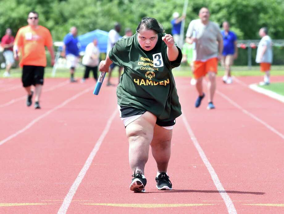 (Arnold Gold/Hearst Connecticut Media)  Katrina Ceballos (center) of Hamden competes in one of the 4x100 meter walk relays at Special Olympics Connecticut Summer Games at Southern Connecticut State University in New Haven on 6/11/2017.
